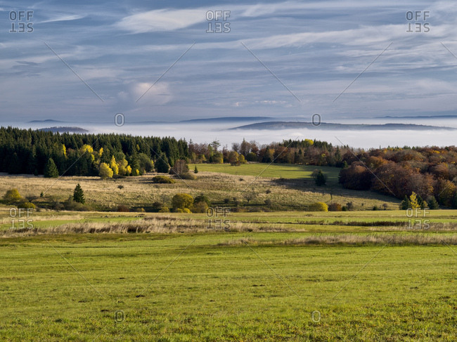 Germany, bavaria, Rhon biosphere reserve, unesco biosphere reserve, long Rhon nature reserve, view from the rhonhof over the autumn-colorful high Rhon to the ellenbogen in thuringia