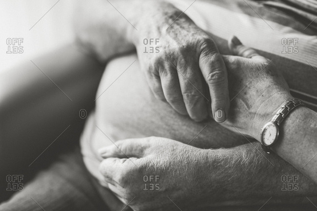 Older couple, holding hands, close-up, detail, s/w