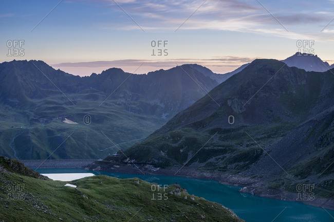 Austria, tyrol, the stubai alps, kuhtai, sunrise behind the finstertaler speicher (reservoir) in the ascent to the sulzkogel