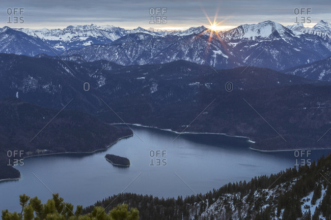 Germany, bavaria, bavarian alps, walchensee, view of the herzogstand on the walchensee at sunrise