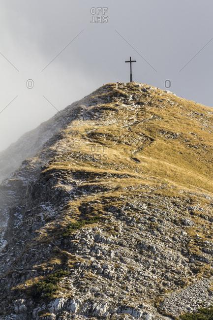 Germany, bavaria, bavarian alps, garmisch-partenkirchen, summit cross of the krottenkopf with the weilheimer hut in the estergebirge