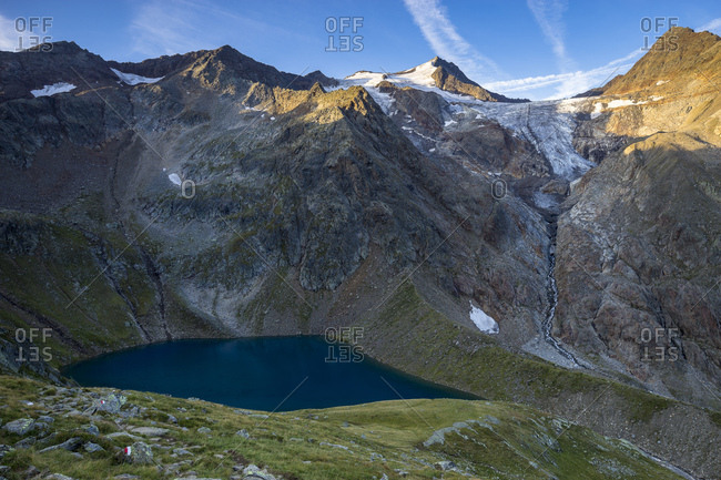 Austria, tyrol, the stubai alps, neustift, morning mood in the grunausee in the stubai with view at wilder freiger and snow-free freiger