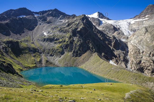 Austria, tyrol, the stubai alps, neustift, grunausee and wilder freiger in summer