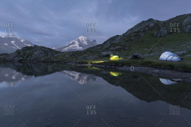 Two tents by the lacs des cheserys, aiguille du chardonnet, aiguilles verte, haute-savoie, france
