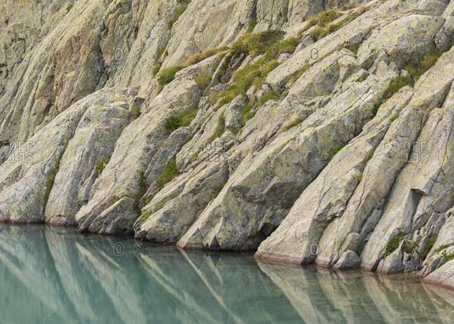 Granite on the shore of lac blanc, haute-savoie, france