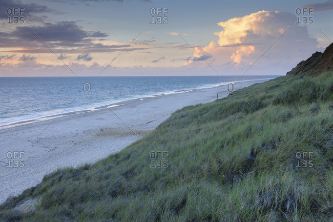 Sundown on the beach of kampen, sylt, north frisia, schleswig holstein, germany