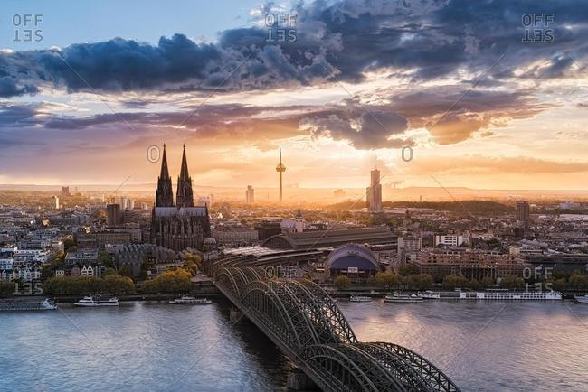 October 18, 2019: City skyline and Rhine river at sunset, Cologne, North Rhine Westphalia, Germany