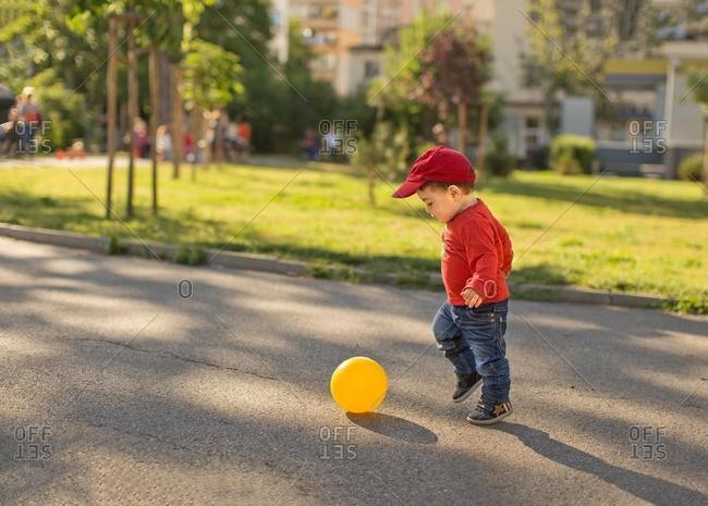 Boy playing football in the street