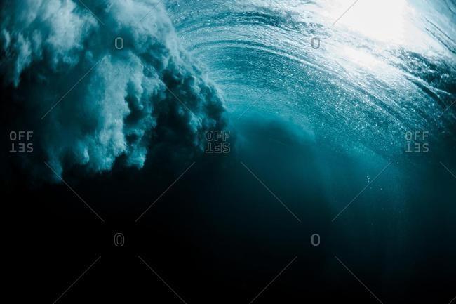 Underwater shot of a wave breaking, Hawaii, USA