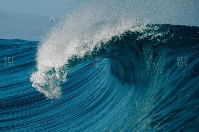 Barrel Wave crashing over reef, Tahiti, French Polynesia