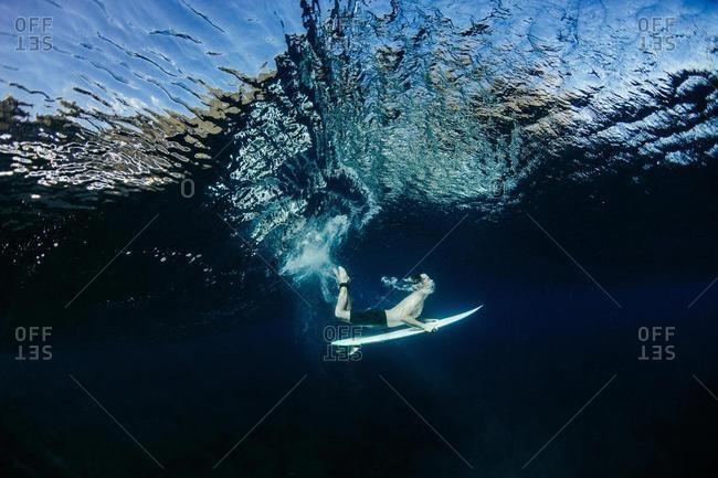 Man Duck Diving under a wave, Hawaii, USA
