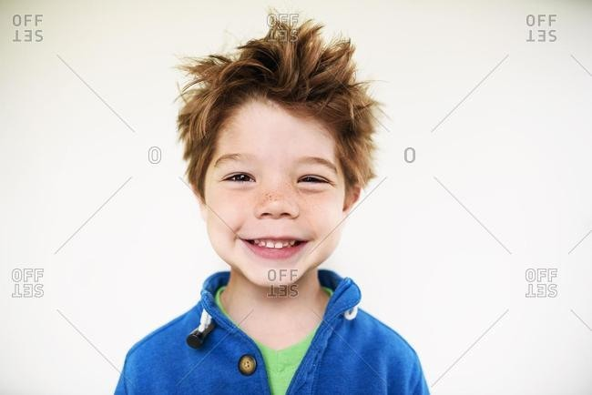 Portrait of a smiling boy with messy hair