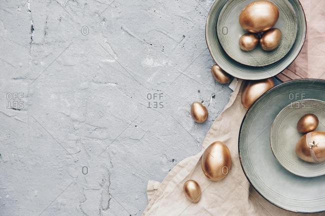 Golden eggs in ceramic bowls