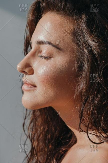 Portrait of a beautiful woman with her eyes closed