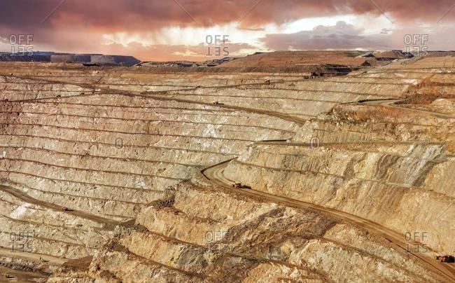 Trucks driving in Super Pit Gold mine, Kalgoorlie, Western Australia, Australia