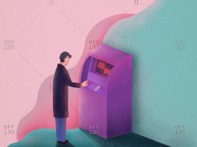 Man standing in front of an ATM withdrawing money