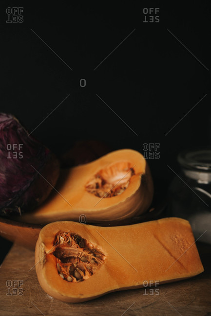 Close up of butternut squash on a rustic kitchen table