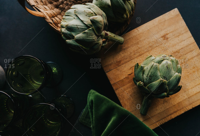 Top view of artichoke on a wooden cutting board