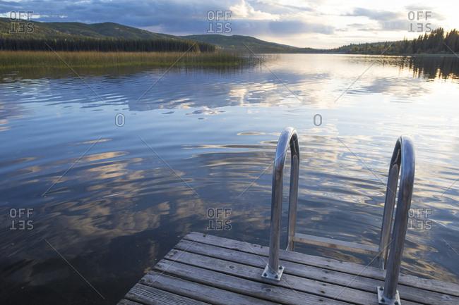 Railing on wooden pier over lake