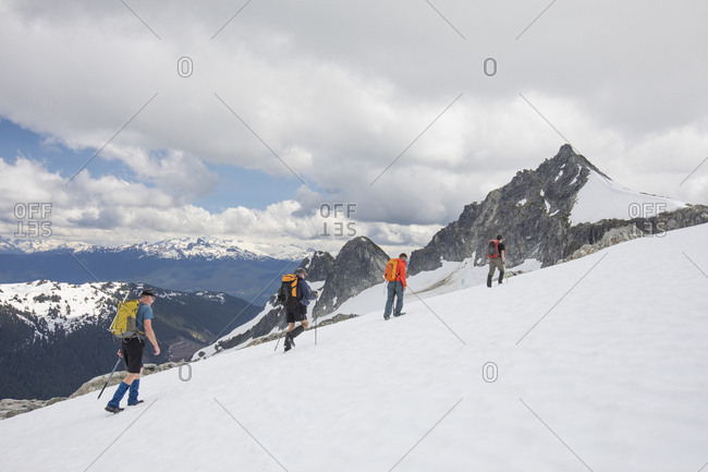 Four mountaineers approach Cypress Peak, British Columbia.