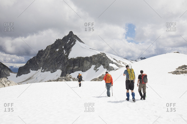 Rear view of four mountaineers approaching Cypress Peak, B.C.