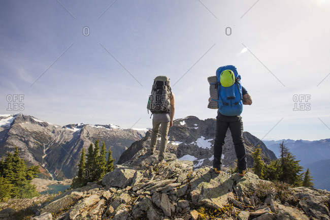 Two mountaineers look at their objective, Douglas Peak, B.C., Canada.