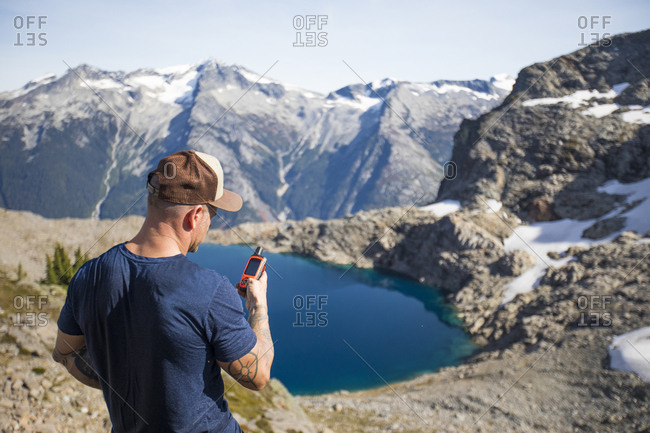 Mountaineer views the climbing route using a GPS device.