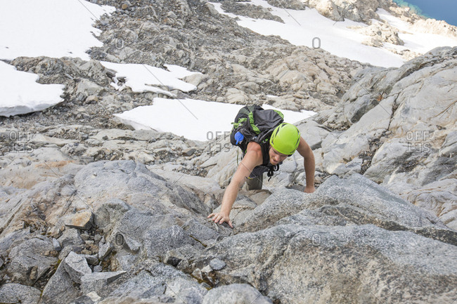 Climber ascends a low angle route on Douglas Peak, British Columbia.