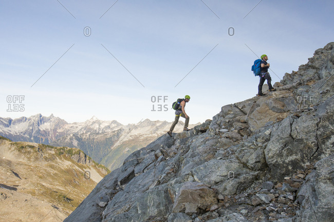 Climbers ascend a rocky ridge on Douglas Peak, B.C., Canada.