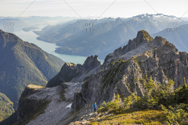 Lone climber looking over Coast Mountains and Harrison Lake, B.C.