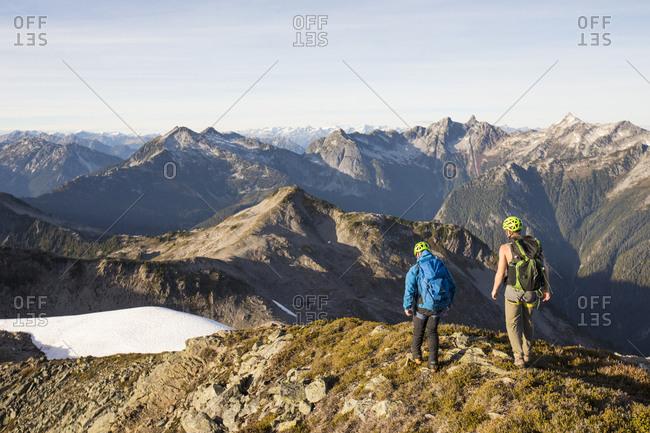 Backpackers hiking along high mountain ridge, B.C.