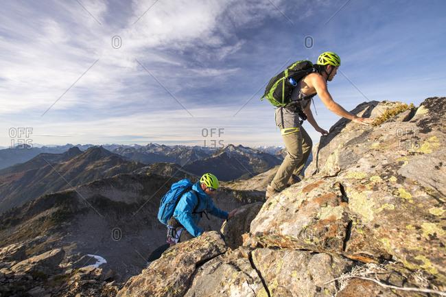 Backpackers scramble up Douglas Peak, British Columbia.
