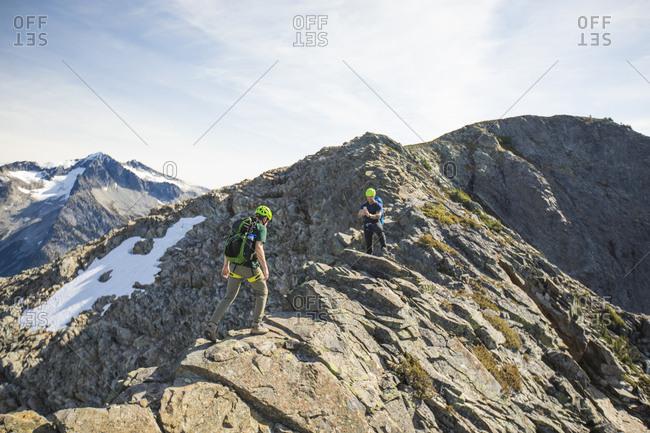 Climbers cross a narrow ridge near the summit of Douglas Peak, B.C.