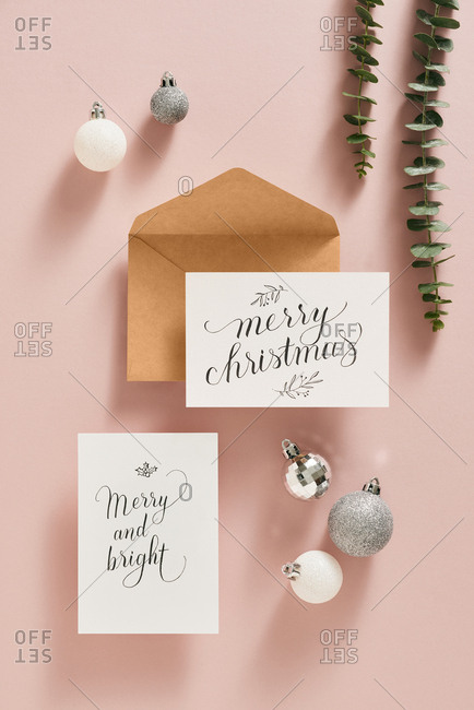 Christmas card with ornaments, leaves and envelope.