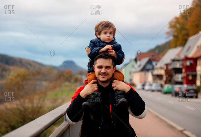 Father with son walking down the street
