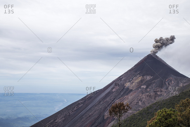 Idyllic view of active volcano at Acatenango against cloudy sky