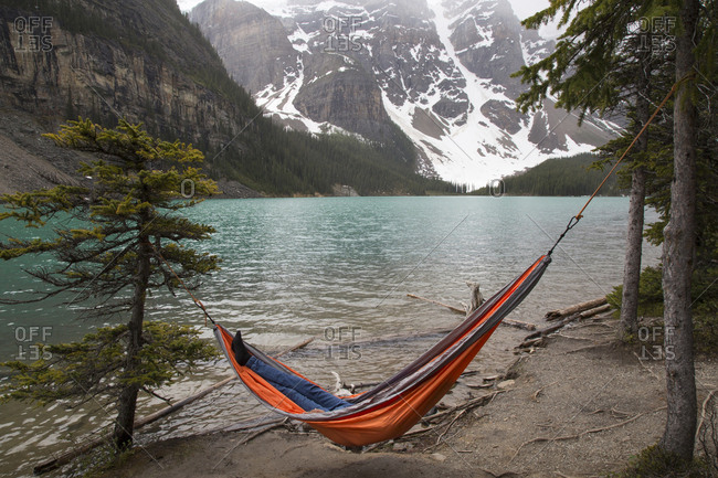 High angle view of hiker resting in hammock by Moraine Lake