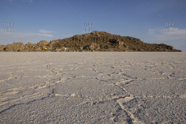 Scenic view of Salar de Uyuni against mountains and sky