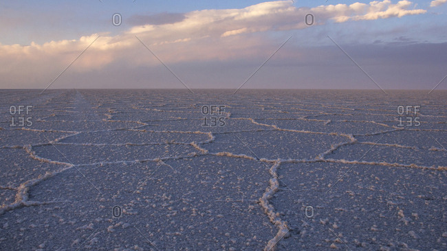 Scenic view of Salar de Uyuni against cloudy sky