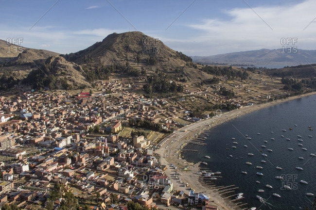 Aerial view of cityscape by Lake Titicaca against mountains