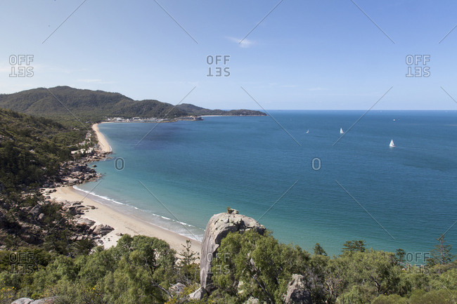 Scenic view of Magnetic Island against sky during sunny day