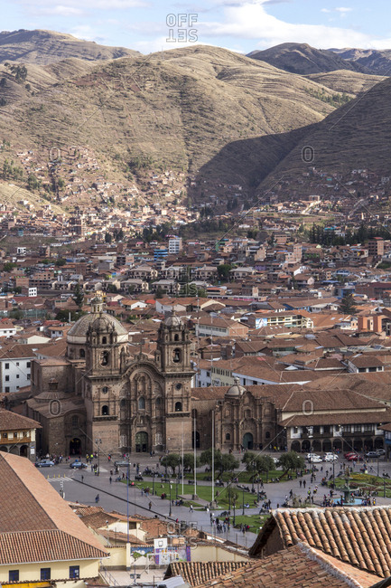 Peru, Cusco - October 21, 2016: High angle view of cathedral amidst houses against mountains in city