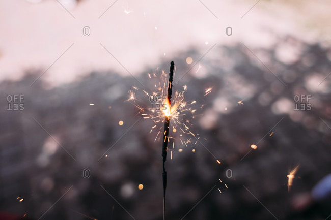 Close-up of lit sparkler during dusk