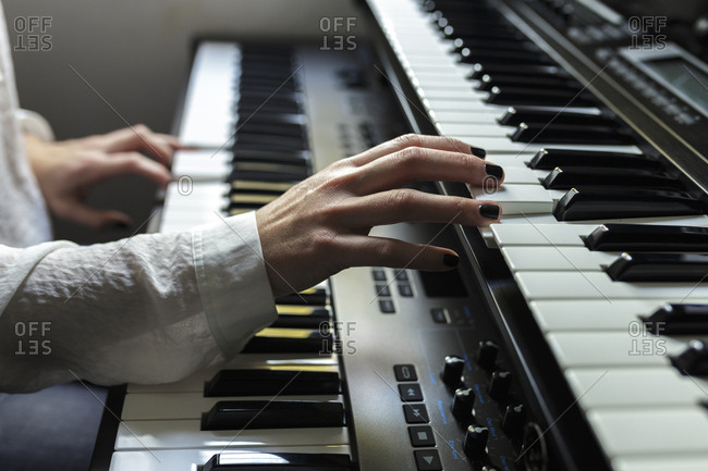 Close-up of pianist practicing piano at home