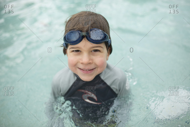 Portrait of confident boy swimming in pool