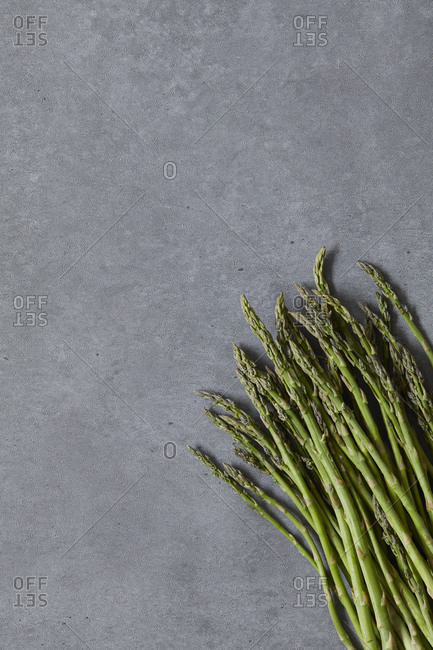 Overhead view of asparagus on concrete table