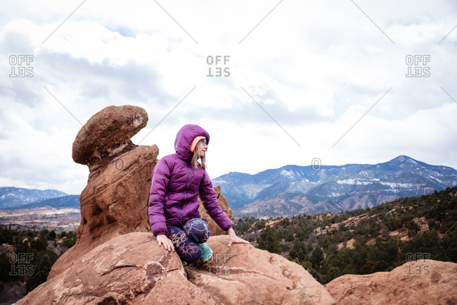 girl on a rock in garden of the gods park