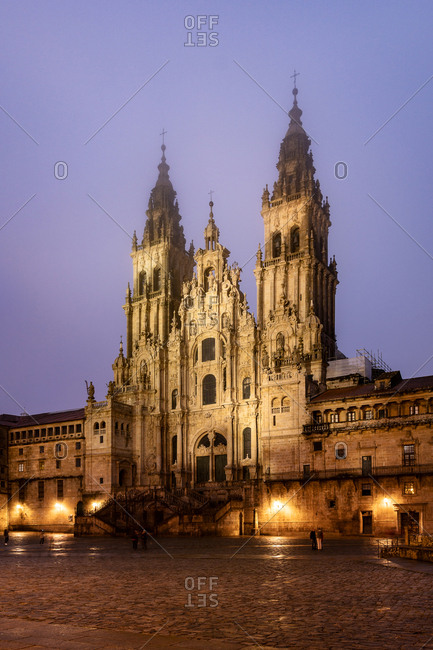 Santiago de Compostela Cathedral view at misty foggy night after rain. Cathedral of Saint James pilgrimage. Galicia, Spain