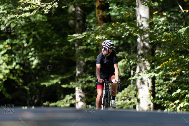 Professional cyclist riding bike in park