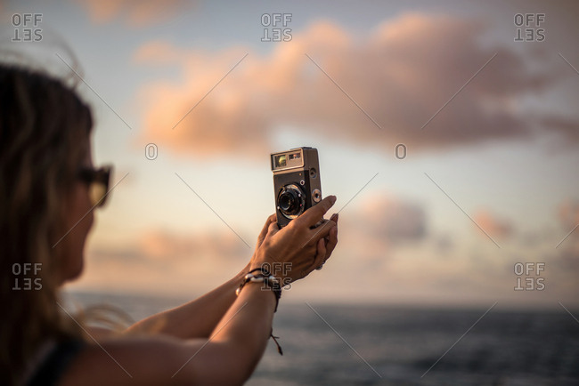 Woman capturing moment taking picture on camera